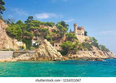 Lloret de Mar Castle on beach. Castell Platja at Sa Caleta beach in costa Brava of Catalonia Spain. Mediterranean sea. Summer vacation in Spain.
