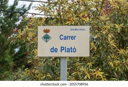 Lloret de mar, Catalonia, Spain - 10.07.2021: Carrer de Plato (Plato Street - in translation) street sign