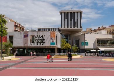 Lloret de Mar, Spain - 08.08.2021: Casa della Cultura (translation Cultural center) in center of city and some people in front