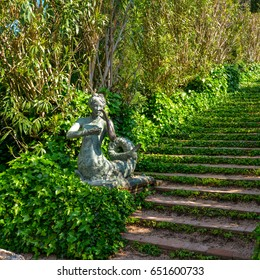 Lloret de Mar, Spain - April 11, 2017: Staircase covered with ivy and sculpture in the Santa Clotilde Gardens in Lloret de Mar.