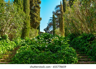 Lloret de Mar, Spain - April 11, 2017: Staircase covered with ivy and sculpture in the Santa Clotilde Gardens in Lloret de Mar
