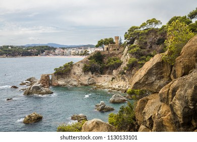 Lloret de Mar / Spain - June 27, 2018: Castle and Beach off the coast of Lloret de Mar on the Costa Brava in Catalonia. View of the city and the beach from the sea.