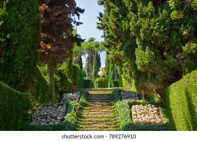 Lloret de Mar, Spain - JUNE, 2016. Santa Clotilde gardens (Jardines de Santa Clotilde) in summer. Beautiful landscape with decorative covered with ivy step ladder in the garden. Costa Brava, Spain.
