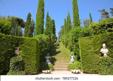 Lloret de Mar, Spain - JUNE, 2016. Santa Clotilde gardens (Jardines de Santa Clotilde) in summer. Beautiful view on staircase with ivy and decorated with statues of mermaids. Costa Brava, Spain.