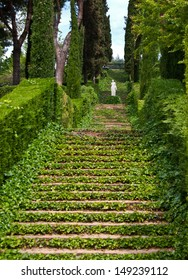 LLORET DE MAR, SPAIN - MAY 6, 2012: These plant-overgrown stairs and the beautiful sculpture in greek style located in one hundred years old Botanical garden on May 6, 2012 in Lloret de Mar.