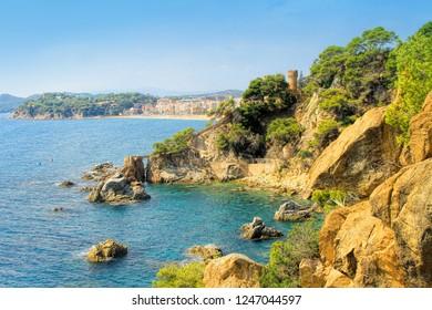 LLORET DE MAR, SPAIN - September 14, 2014: Seaside with Sant Joan castle in Lloret de Mar, Costa Brava, Catalonia, Spain