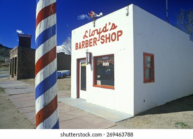 Lloyd's Barber shop with barber pole in foreground, Lyons, Colorado