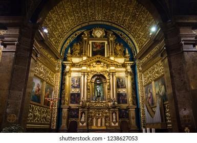 LLUC, MALLORCA, SPAIN - OCT 1, 2018: Ornate altar inside of the Santuari de Lluc church on Mallorca. Beautiful paintings of The Saints.