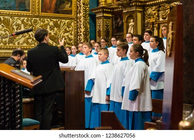 LLUC, MALLORCA, SPAIN - OCT 1, 2018: The Blauets of Lluc choir singing in the Basilica within the Monastery of Lluc, Mallorca island, Spain