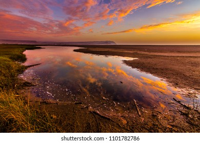 Lluta river wetlands at Arica, Chile. Amazing reflections with the sunset.