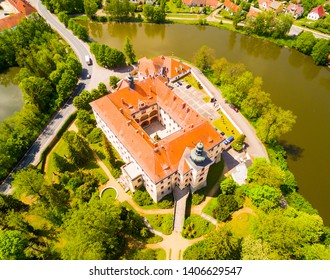 Lnare Castle is located in the village of the same name in the Strakonice district of Southwestern Bohemia. Built in the 17 century in Baroque style. Aerial view to famous Czech landmark. Europe.