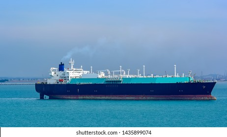 LNG gas carrier vessel in ballast anchored on outer anchorage in the Strait of Singapore.