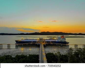 LNG ship moored at sunset
