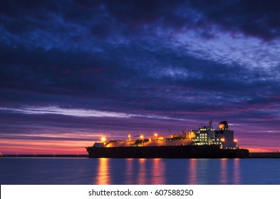 LNG TANKER AT THE GAS TERMINAL - Sunrise over the sea