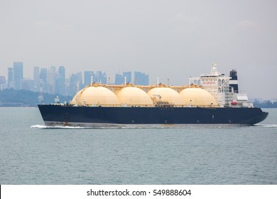 LNG tanker is passing by Singapore.
