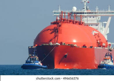 LNG TANKER AT SEA. Large tanker flows for the escort tugs