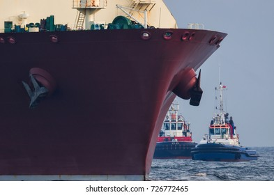 LNG TANKER, TUG AND FIREBOAT-  Ship safety secured by fireboat and tug