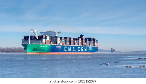 The LNG-powered containership, the CMA CGM, on the river Elbe near the city of Hamburg, Germany. Ship is leaving the port of Hamburg on Sunday the 14th of February 2021.