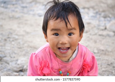 Lo Mantang, Upper Mustang / Nepal - August 24, 2014: Portrait of a little smiling girl of Tibetan ethnicity in a pink dress