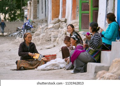 LO MANTHANG / NEPAL - August 24, 2014: Unidentified Nepalese women are sitting on the street, talking and combed wool in the Lo Mantang city, the capital of the Upper Mustang. Nepal.