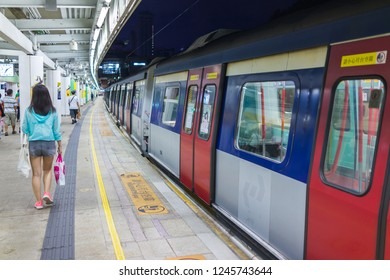 Lo Wu, Hong Kong - SEP 2017: The passengers are walking on the subway platform of MTR Lo Wu Station, East Rail Line.