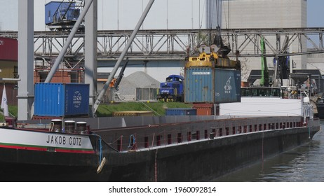 Load and offload of freight mooring ships at harbour in Basel. CH Switzerland, 21th April 2021