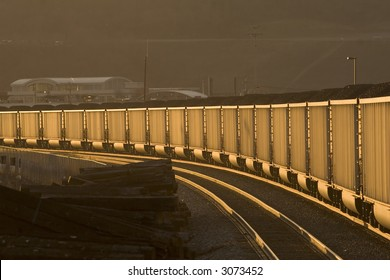 Loaded coal hoppers at twilight.