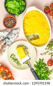 Loaded gratin, julienne or casserole from baked mushroom with chicken and cheese in bechamel sause, white ceramic dish, shallow depth of the field, top view, copy space for you text.