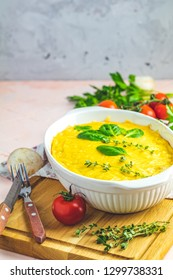 Loaded gratin, julienne or casserole from baked mushroom with chicken and cheese in bechamel sauce, white ceramic dish, shallow depth of the field, copy space for you text.