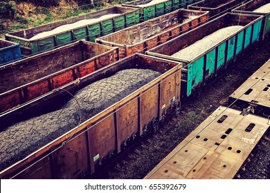 Loaded rail cars from above. Cargo transportation by rail.