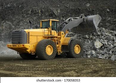 Loader construction machine in mine stone