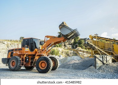 A Loader excavator mining and construction machinery equipment in operating action