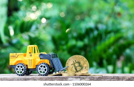 Loaders golden bitcoin from coin and nature background.