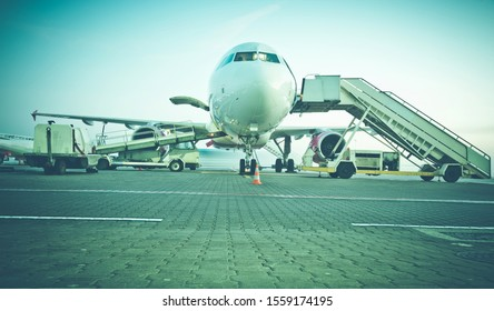 Loading the aircraft before flight. A passenger plane on the tarmac from the front. Favorite means of transport for travelers visiting the whole world.