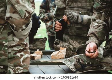 Loading ammo magazine. Military training. War concept