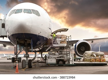 Loading cargo on plane in airport before flight