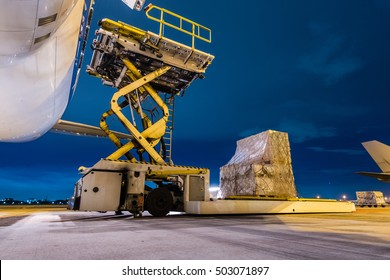 Loading cargo on the plane at airport, twilight time