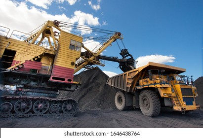 Loading coal into a truck with an excavator. Mine