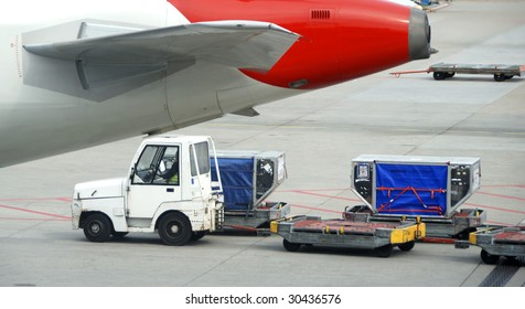 Loading a commercial airplane. No brands and or people.