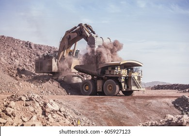 Loading of copper ore on very big dump-body truck