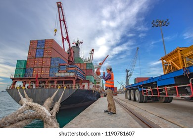 the loading and discharging operation container ship vessel in port takes control by stevedore and foreman in charge, working in port terminal being for logistics and transport services to worldwide