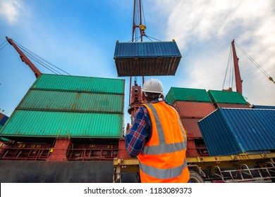 the loading and discharging opertion container ship vessel in port takes control by stevedore and foreman in charge, working in port terminal being for logistics and transport services to worldwide