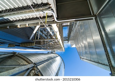 Loading facility building exterior. Low angle view of the tanks and agricultural silos of grain elevator storage. View from below.