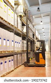 Loading goods with forklift in distribution warehouse
