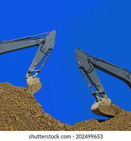 Loading gravel excavators.