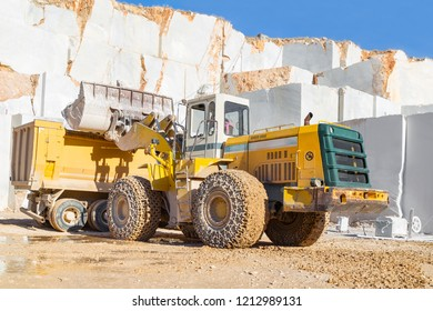 Loading into tipper truck by the bulldozer working in the marble quarry in Afyonkarahisar of Turkey. November  2016