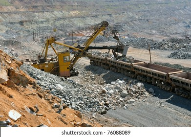 Loading of iron ore on the train in career