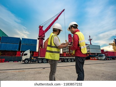 loading master, supervisor, foreman, port controller working in charge in port terminal, checking unit containers report online for loading discharging operation takes control by swift report