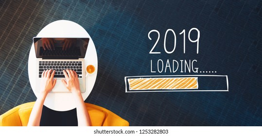 Loading new year 2019 with person using a laptop on a white table