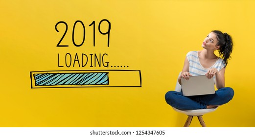 Loading new year 2019 with young woman using a laptop computer